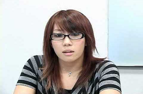 Wrestlers outside the ring Kanako Urai, then known as Kana, was interviewed by Gordman of Gordman's Game Treasure wearing a black and grey striped shirt and wearing glasses