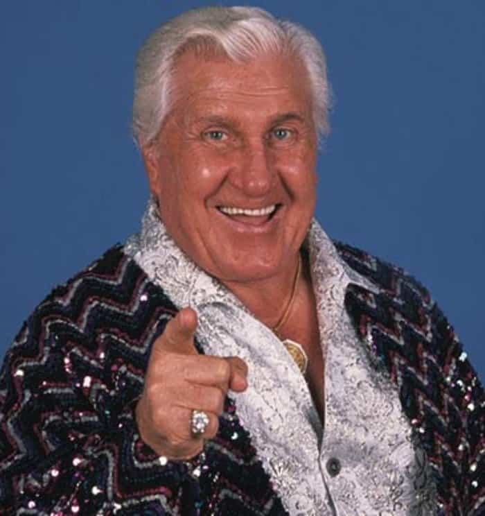 Classy Freddie Blassie on our top 10 wrestling managers list in a sequined jacket and paisley shirt pointing