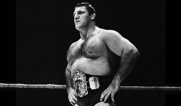 Bruno Sammartino in his younger days inside the ring with a title belt on.