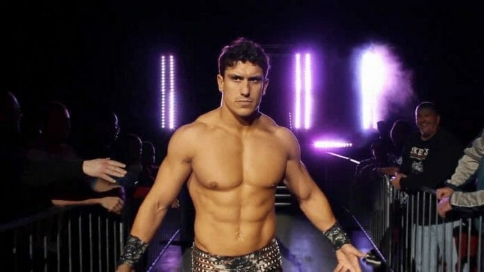 "EC3 entering to his wrestling music, ""Trouble"" in black leather studded pans and concentration on his face"