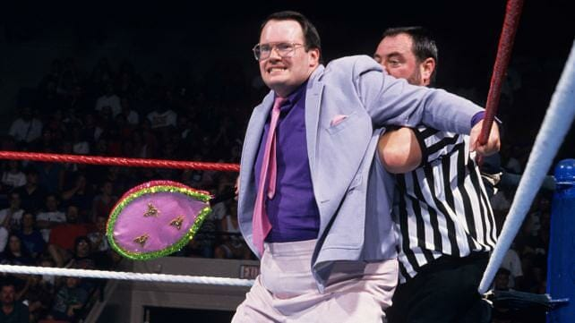 Jim Cornette is No. 2 on our list of greatest managers of all time stands in the ring blocking a referee from interfearing