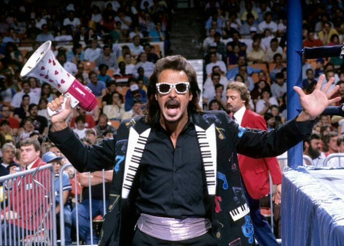 Wrestling managers Jimmy Hart getting the crowd excited ring wide with a megaphone