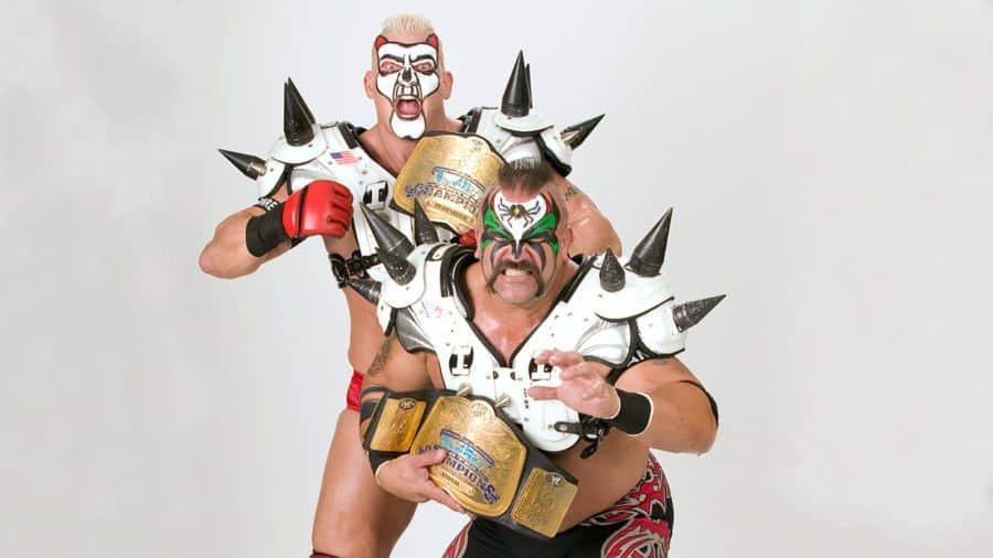 The Legion of Doom (as 'LOD 2005' with Animal and Jon Heidenreich) posing with title belts in makeup and spiked shoulder pads
