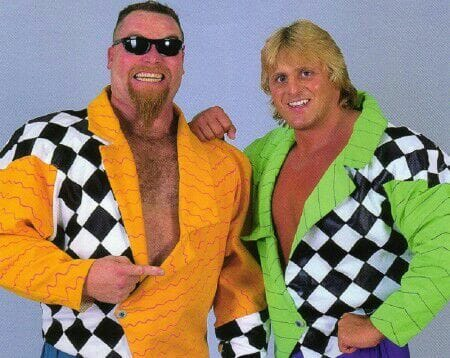 Tag Team The Hart Foundation (as 'The New Foundation' with Jim Neidhart dressed in a yellow jacket with black and white checkerboard on one side & Owen Hart in the same jacket but with neon green)