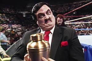 Best Wrestling Managers Paul Bearer with a mean look on his face ring side holding an urn