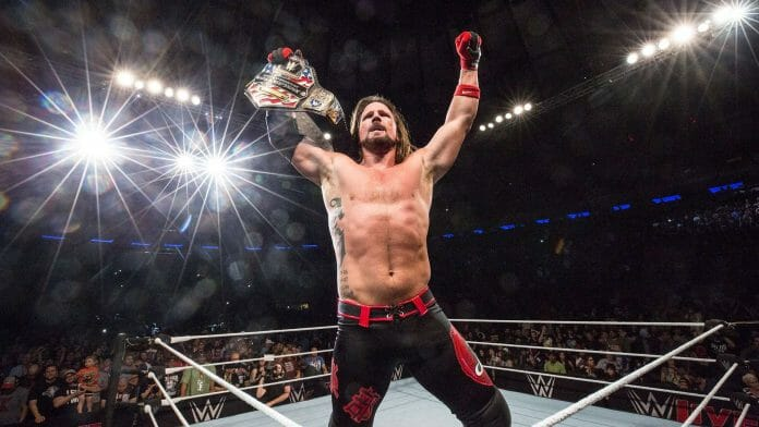 AJ Styles holding the United States Championship title belt after a surprise win over Kevin Owens at a Madison Square Garden house show on July 8th, 2017