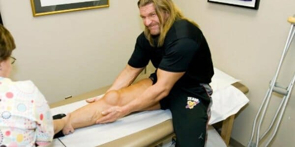 A Dr. Looking at Triple H Injury that was a Second Quad Tear, Right Side