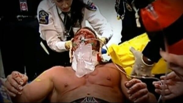 After a Triple H Injury to the throat he is photographed being carried out on a stretcher by paramedics