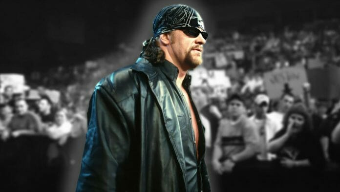 The Undertaker walking through an arena of fans amid rumors that Eric Bischoff was trying to snag him to the WCW