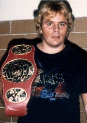 Bruce Hart Holding Title Belt