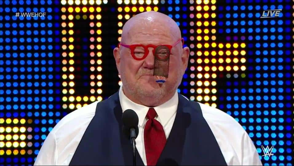 Vader with red glasses on that have an eyeball popping out on a spring at the 2016 WWE Hall of Fame ceremony