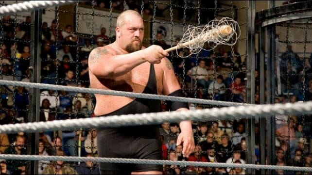 Wrestling Stipulations Never Used Again - Big Show holding a baseball bat with barbed wire around it inside the cage at December 3, 2006's December to Dismember pay-per-view event