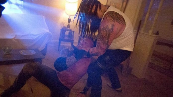 Wrestling Stipulations Never Used Again -Bray Wyatt chokes out Randy Orton in a dim-lit living room in their 2017 House of Horrors match