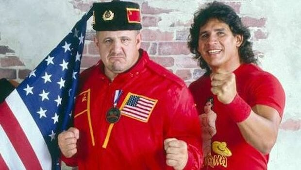 Nikolai Volkoff stories - Nikolai with his Soviet hat, red jacket with the Soviet Union and American flag on it alongside Tito Santana