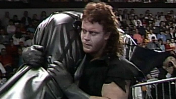 The Undertaker's First Year in WWE - The Undertaker carrying a body bag out of the ring
