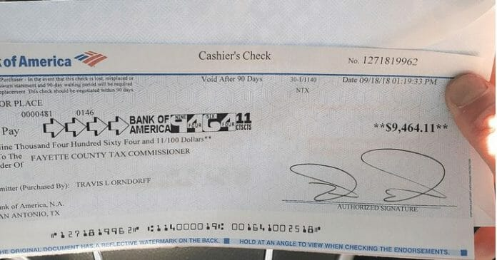 Here is the cashier's check used to pay off Paul Orndorff's property tax debt thanks to the contributions from fans and wrestlers alike.