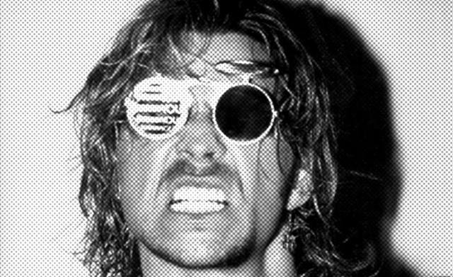 Black and white photo of Brian Pillman 'The Loose Cannon' with sunglasses on
