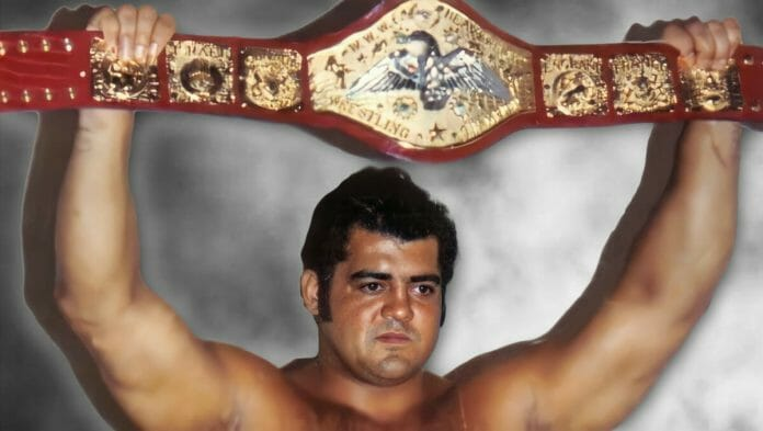 Pedro Morales proudly holds the WWWF (WWE) Heavyweight Championship above his head.