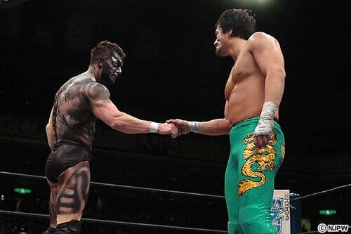 Taguchi and Devitt shook hands after the match at NJPW's Invasion Attack 2014, signifying the end of his time in the Bullet Club and New Japan