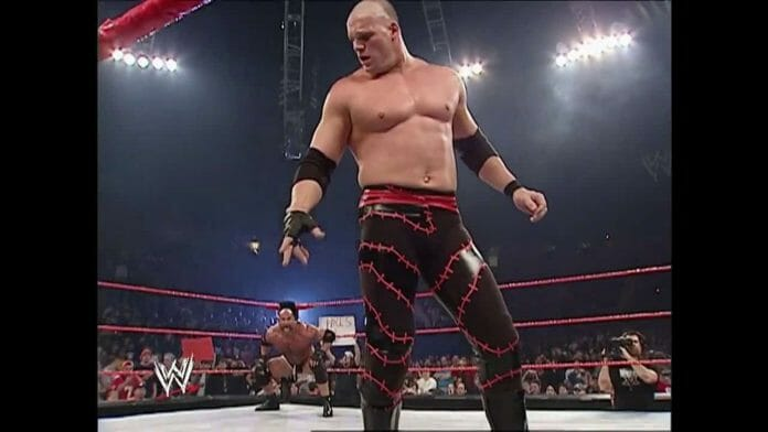 In the later part of 2003, Kane would get rid of the vest top and wear more traditional black wrestling tights with red, wrapped barbed wire decals