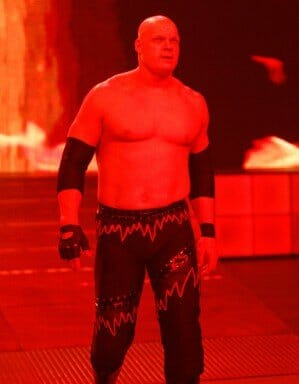 After wearing the same attire for seven years, in 2010 Kane's attire would alter slightly, changing the wire with a red heart monitor like rhythm strip and splashes of grey.