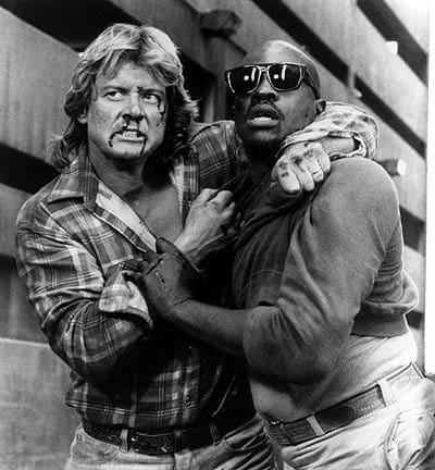 Roddy Piper and Keith David in the film They Live