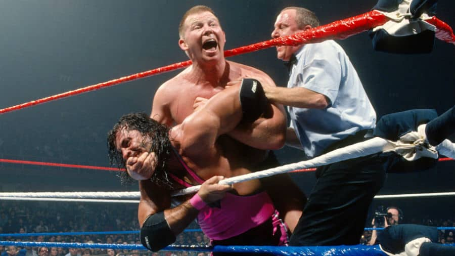 Bob Backlund has Bret Hart locked in the crossface chickenwing during their special submission match for the WWF World Heavyweight Championship at November 23rd, 1994's Survivor Series pay-per-view in San Antonio, Texas