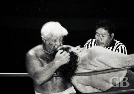 Keith Elliot Greenberg shares a story on Freddie Blassie vs. Rikidozan where 100 people died of heart attacks due to the amount of gore the matches involved