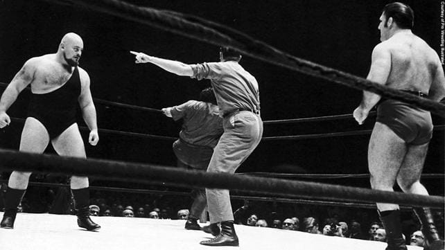 Black and white photo of Ivan Koloff about to square off against Bruno Sammartino in a wrestling ring.