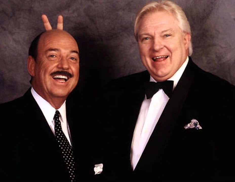 Mean Gene Okerlund and Bobby Heenan with Heenan giving Okerlund bunny ears behind his head