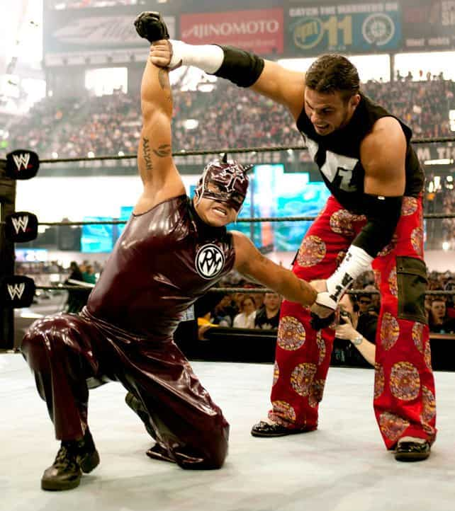Rey Mysterio as Daredevil against Matt Hardy at WrestleMania 19. The outfit consisted of dark red bottoms and vest, with a black and white RM logo on the top left of his chest. His mask, whilst still maintaining the wings and crucifix, exposed more of the lower half of Mysterio's face than usual and also incorporated two devilish horns protruding from Rey's forehead.
