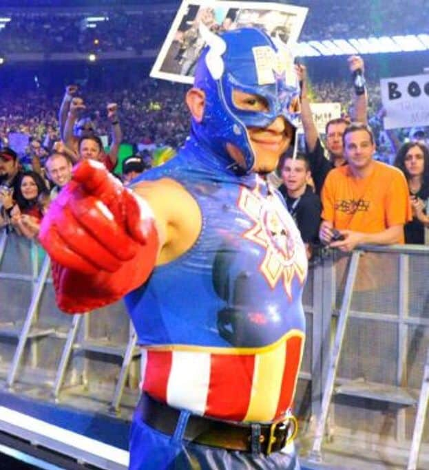 Rey Mysterio as Captain America at WrestleMania 27. Draped in caps red white and blue, complete with his trademark side wings and exposed ears (a bold superhero fashion choice if there ever was one) Rey's WM 27 was a perfect choice for battling the villainous Cody Rhodes. Other than the Aztec design on the chest star, this one is pretty much a straight-up tribute to the Marvel Comics legend. In place of Caps forehead