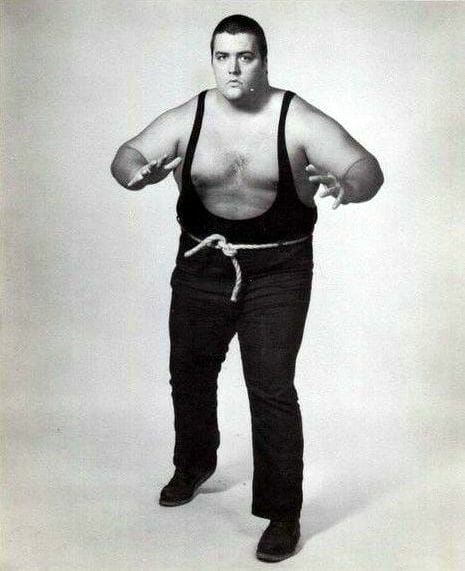 King Kong Bundy, then known as 'Big Daddy' Bundy, while with Fritz Von Erich's World Class Wrestling in Texas. He wore blue jeans, a rope belt, and sported hair on top.