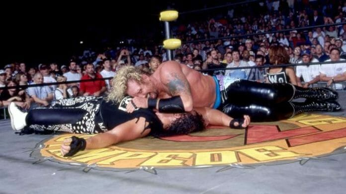 "DDP gets the 1-2-3 victory over ""Macho Man"" Randy Savage at WCW's Spring Stampede pay-per-view, April 6, 1997."