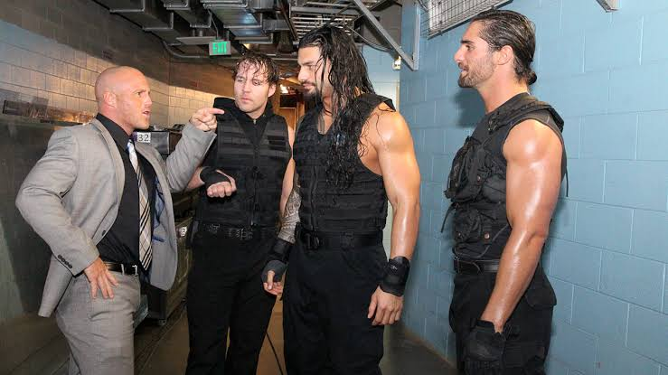 Joey Mercury seen backstage giving pointers to Dean Ambrose, Roman Reigns, and Seth Rollins of The Shield