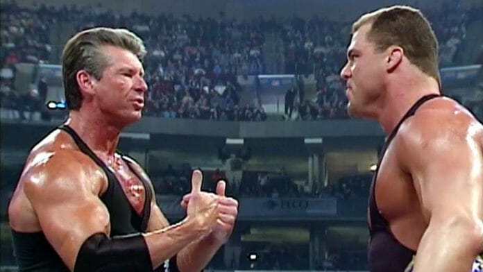 Kurt Angle and Vince McMahon, pictured here from a March 28th, 2002 SmackDown taping, had a scuffle at 38,000 feet. A sleeping Undertaker awoke and acted accordingly!