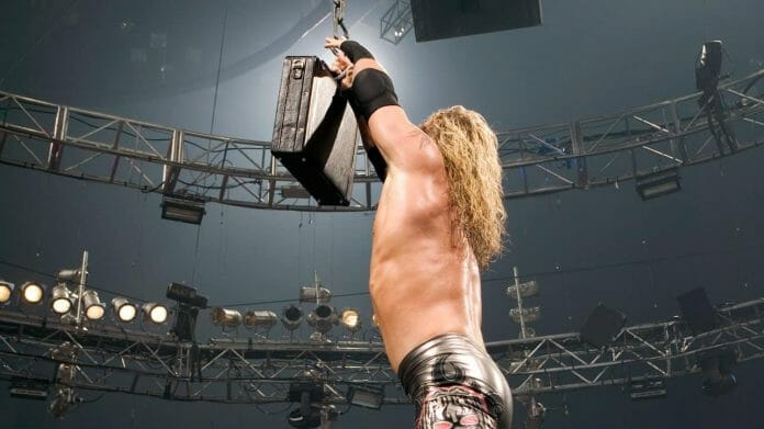 Edge ascends the ladder and reaches for the briefcase to become the first ever winner of a WWE Money in the Bank match at WrestleMania 21