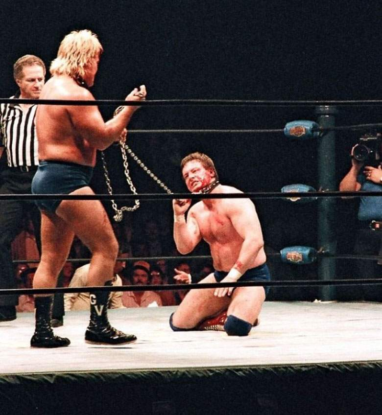At NWA Starrcade 1983, Roddy Piper and Greg Valentine competed in one of the most dangerous matches of their career - a Dog Collar match. Both combatants bashed each other with the steel chain that bound them together throughout the entirety of the bout. They would perform this violent match over forty times throughout the territory. [TM / Photo Copyright - Wayne C. Culler]