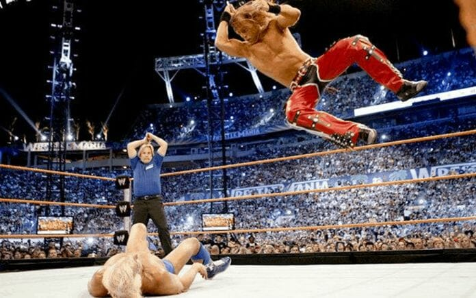 Charles Robinson reacts emotionally in the background as he calls his idol Ric Flair's retirement match against Shawn Michaels at WrestleMania 24