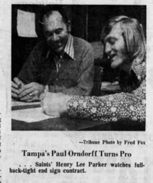Paul Orndorff signing a contract to play for the NFL's New Orleans Saints