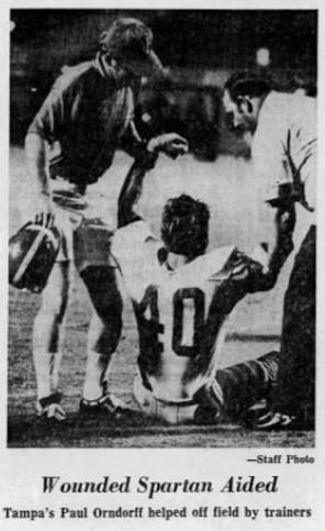Orndorff gets help off the field after breaking his cheekbone during his sophomore year at University of Tampa
