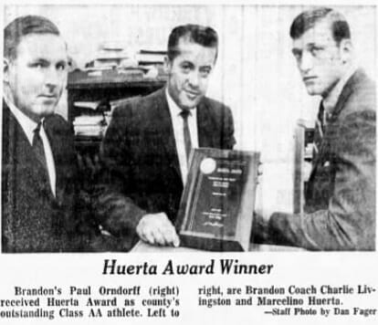 Paul Orndorff accepts the Huerta Award as his county's most outstanding Class AA athlete, one of the highest awards he won while playing football.
