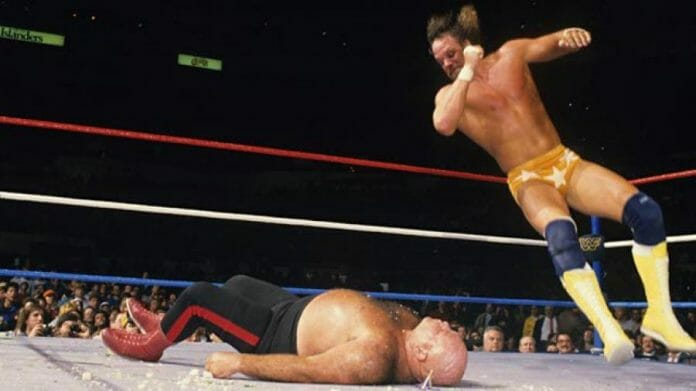 Randy Savage dropping an elbow on George 'The Animal' Steele at WrestleMania 2. Steele's old school methodology clashed with Savage's approach in many ways.
