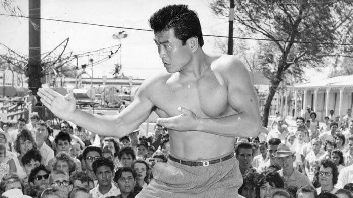 Fans look on as Hiro Matsuda gives a martial arts demonstration.