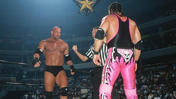 Former WCW Tag Team Champions Goldberg and Bret Hart face off at WCW Starrcade 1999. A botched kick later in the match would mark the end of Bret Hart's wrestling career.