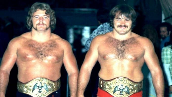 Mike Graham and Kevin Sullivan as NWA Florida tag team champions.