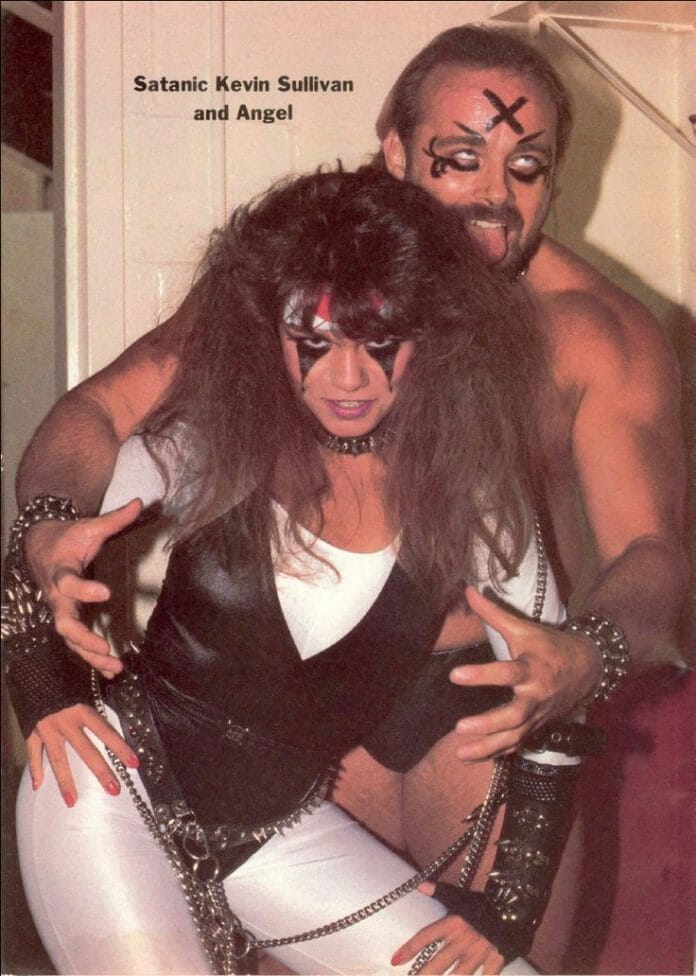 Satanic Kevin Sullivan and Angel (Nancy Benoit). Note the word