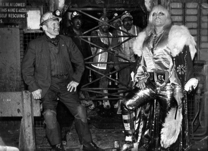 Adrian Street, seen here with his father on the left, is looking fabulous in his return to the coal mine. Notice the other miners in the background. [Photo by Dennis Hutchinson]