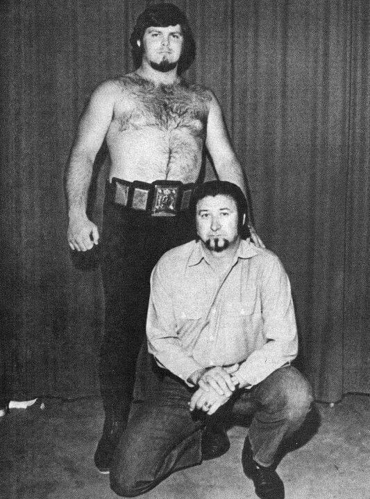 Jerry Lawler with the NWA Southern Heavyweight Championship (Mid-America version) title (circa 1974-1977) and his manager Sam Bass. (Previously, this belt was also used as the NWA Southern Jr. Heavyweight title from 1952 to 1974.) The title moved from NWA Mid-America to the Continental Wrestling Association on March 20, 1977. The title was renamed the AWA Southern Heavyweight Championship in July 1978, when the CWA established a working relationship with the American Wrestling Association.