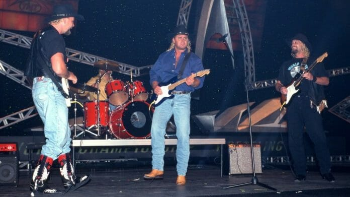 Is that a D chord? The West Texas Rednecks (Barry Windham, Kendall Windham, Curt Hennig, and Bobby Duncum Jr.) perform live.